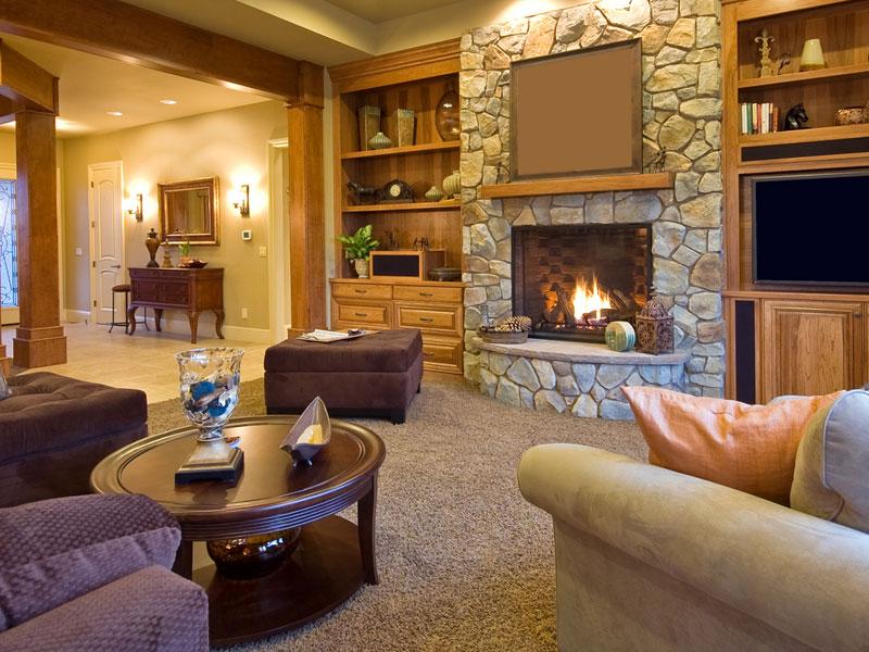 Фото дизайна гостиной с камином в квартире